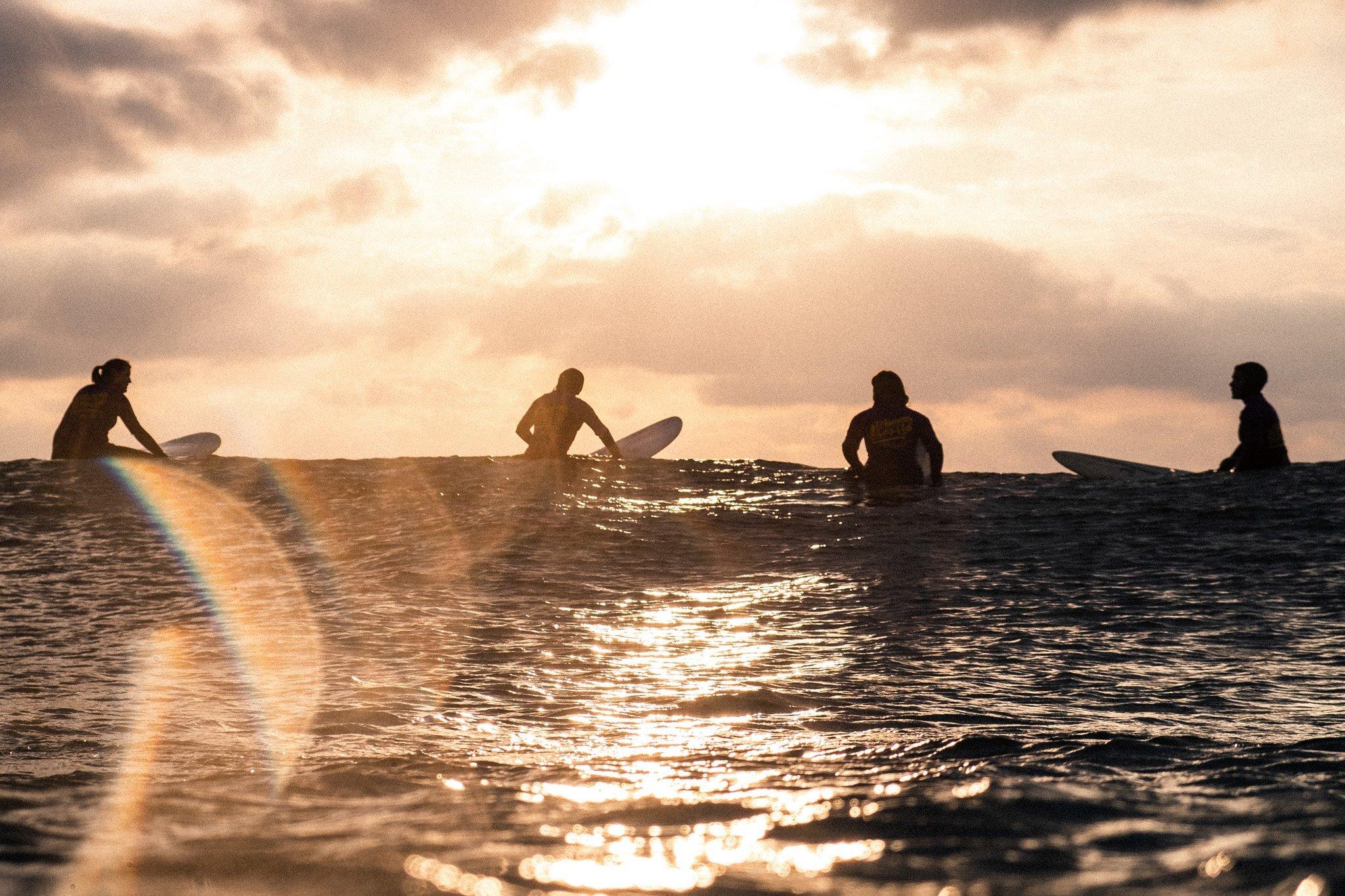 Women on waves 4 surfers enjoying a sunset session